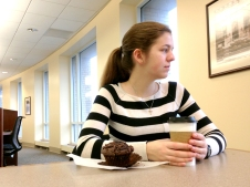 Freshman journalism student Jennifer Skinner ponders the outside world while sipping coffee and munching on a muffin in the Downtown Library on Jan. 29,2015. Jen really loves muffins, so she had one.