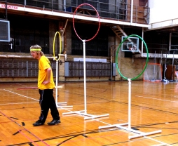Junior Ian Walton takes a quick break from flying on his broom by the goal hoops at Quidditch Club practice on Feb. 5. The team played two scrimmage rounds.