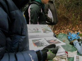 A participant checks out Mack's graduation book to learn more about birds in our area.