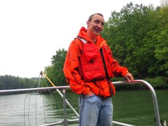 Peter Jenkins dons his PFD to stay safe on the boat. PC: Jillian Clemente