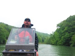 David Wellman, District 1 WV DNR Biologist, drives the electrofishing boat around Stonecoal Lake to get to the shoreline to shock some fishes. PC: Jillian Clemente